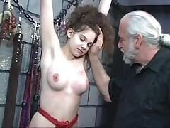 Youthful brunette hair is gagged, spanked and whipped in the basement by dom